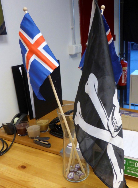 Jolly Rogers pirate flag and Icelandic flags are seen at the Icelandic Pirate Party's headquarters in Reykjavik, Iceland, September 19, 2016. Picture taken September 19, 2016. (Stine Jacobsen / Reuters)
