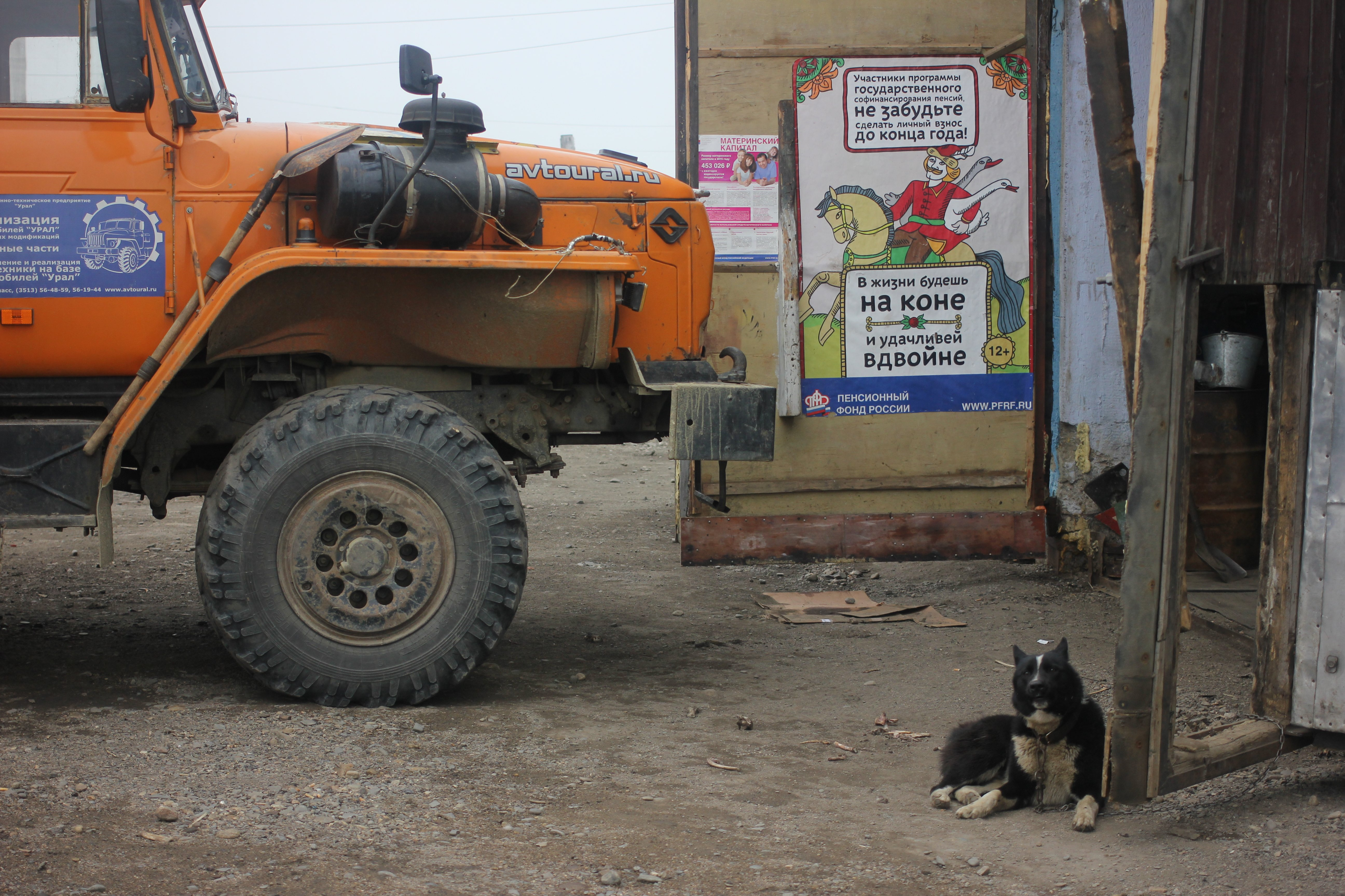 A six-wheel bus parked at a mechanical shop in Lorino, Chukotka, July 2016. There are only a few gravel roads connecting communities in the region, and buses provide the majority of overland transportation. (Kirsten Swann / Alaska Dispatch News)