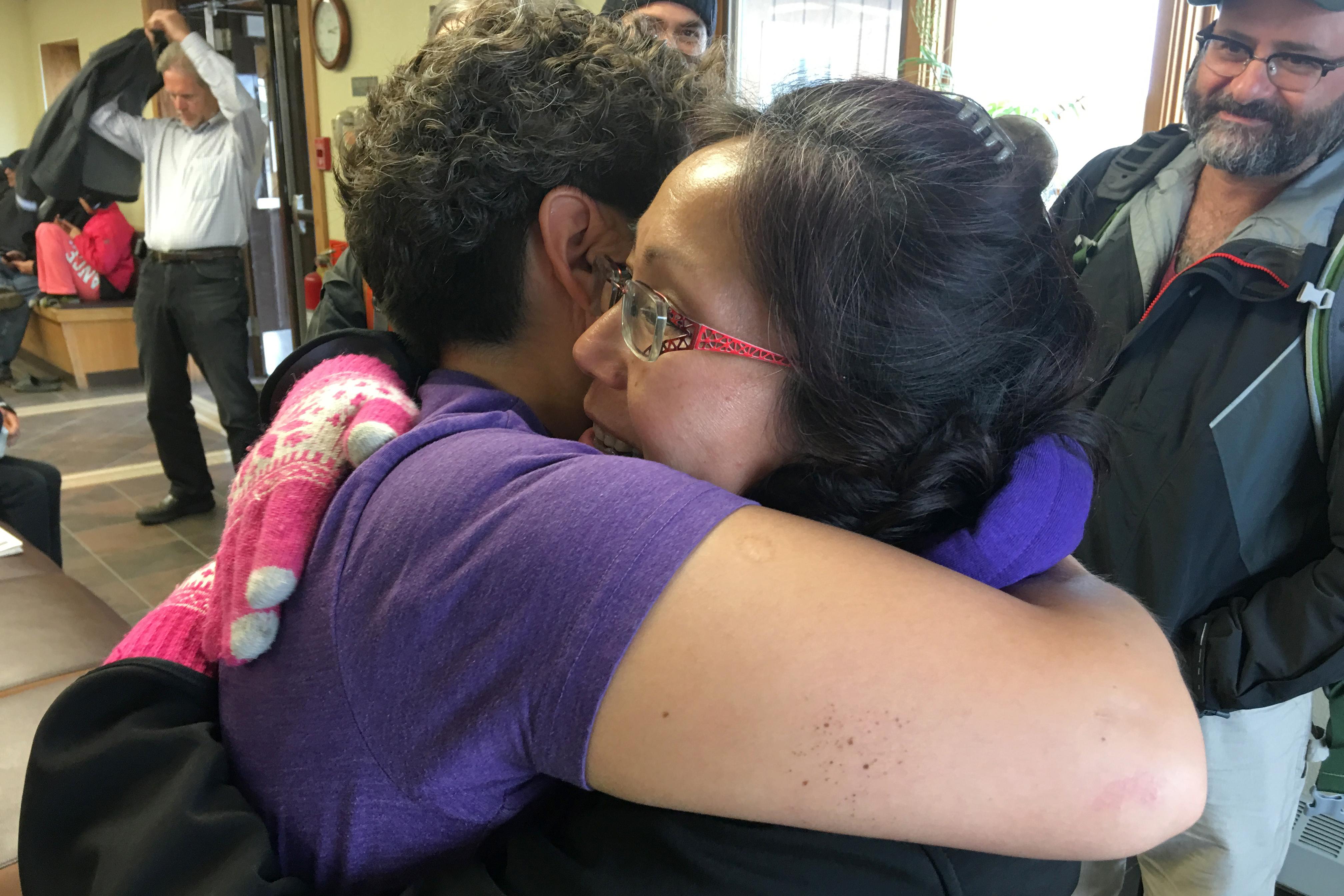 Etta Tall bids farewell to a friend in Nome before boarding a flight to Provideniya, Russia, June 2016. (Kirsten Swann / Alaska Dispatch News)