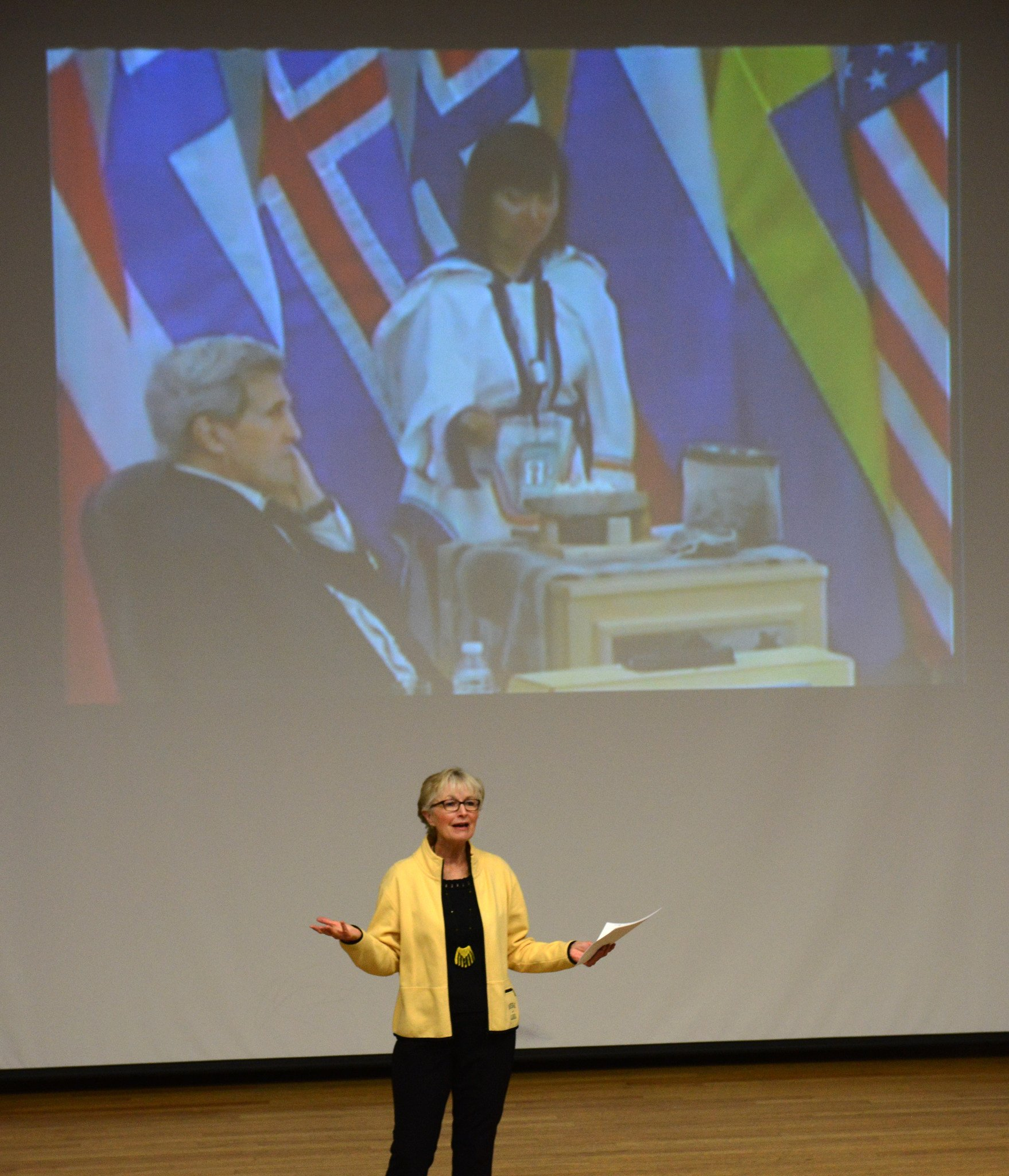 Fran Ulmer welcomes viewers to a live-stream showing of the Arctic Council meeting held in Iqaluit, Nunavut, Canada on Friday morning, April 24, 2015, at UAA. Ulmer, chair of the U.S. Arctic Research Commission, will serve on the U. S. chairmanship team as leadership is passed from Canada to the U.S. and Secretary of State John Kerry, above left. Kerry greeted Ulmer and Alaskans watching the event in his remarks. (Erik Hill / Alaska Dispatch News)