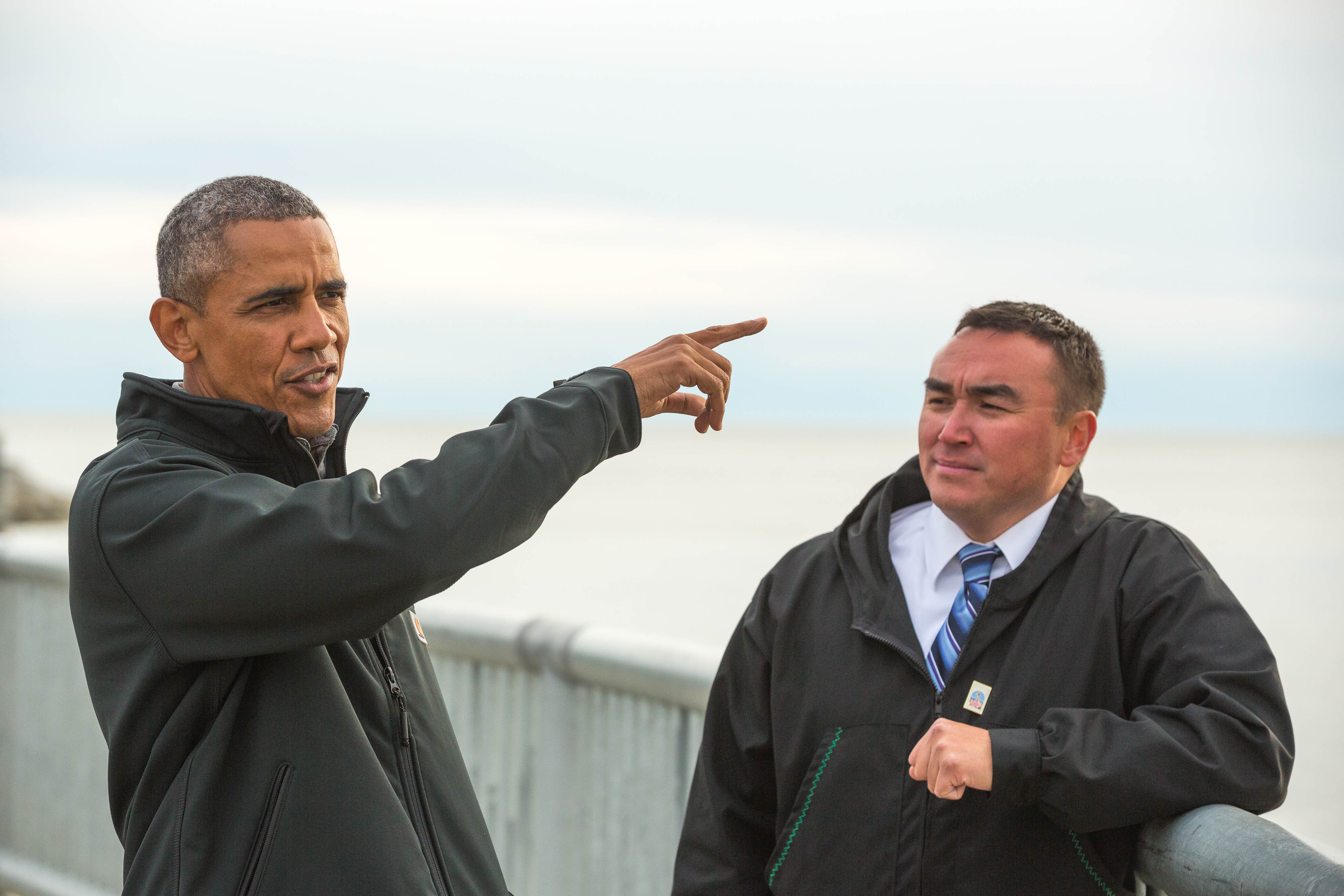 With Kotzebue City Manager Derek Martin, President Obama views the seawall that protects the community from winter storm surges on Wednesday, September 2, 2015. (Loren Holmes / Alaska Dispatch News)