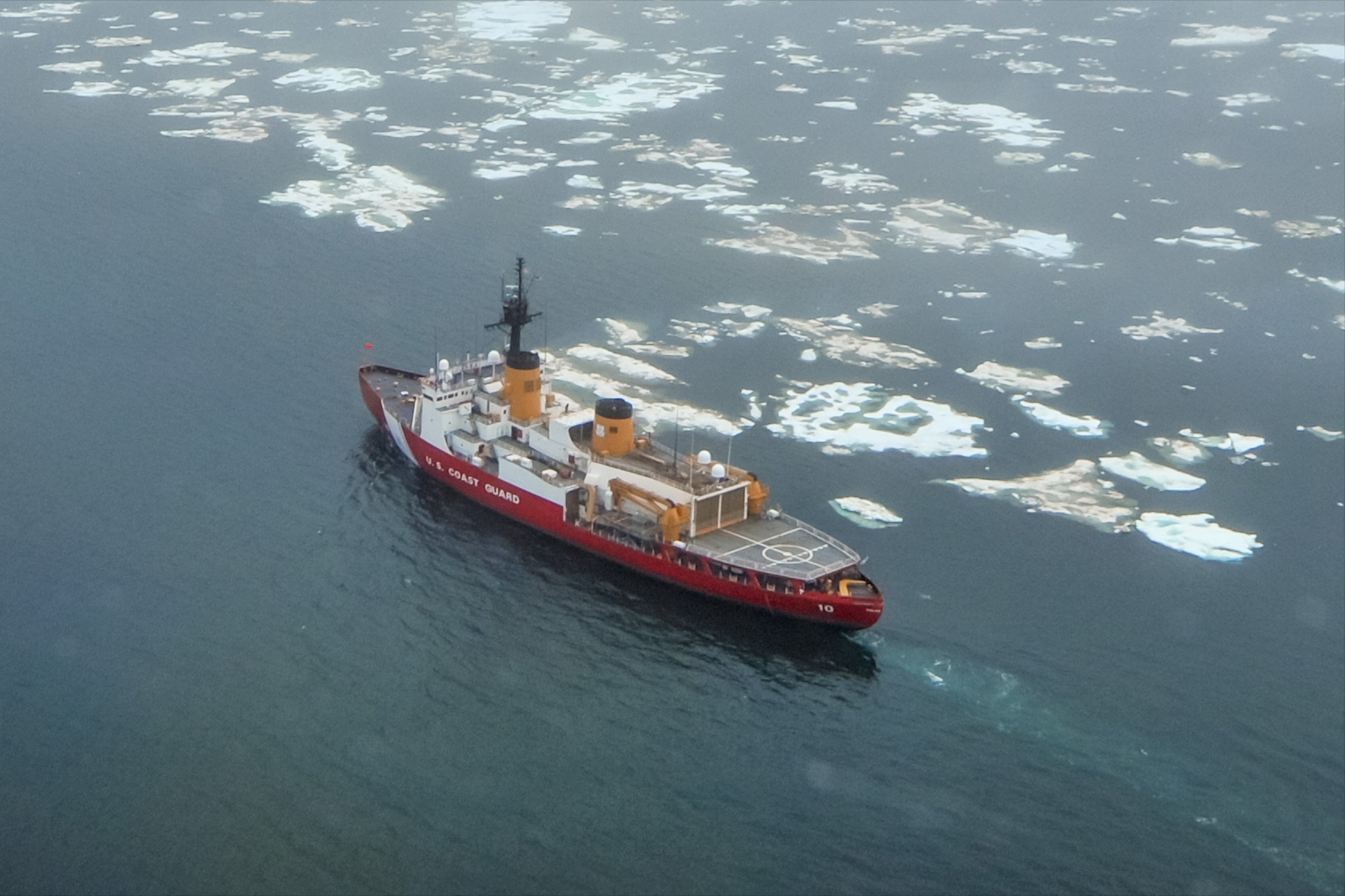 The Coast Guard Cutter Polar Star transits near the beginning of the ice edge in the Chukchi Sea north of Wainwright, Alaska, Tuesday, July 16, 2013. The heavy icebreaker's crew are undergoing ice trails following the conclusion of a major overhaul in 2012 to return the ship to service. (Petty Officer 1st Class Sara Mooers / U.S. Coast Guard)