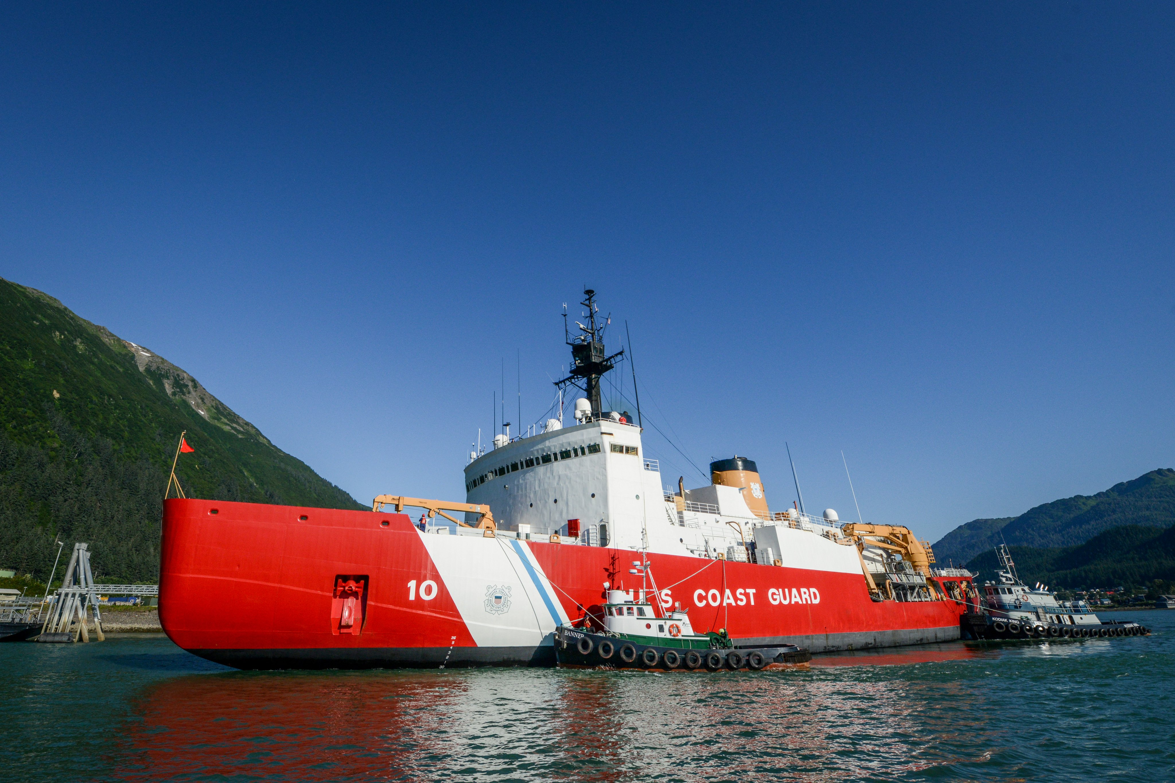 The crew of the Coast Guard Cutter Polar Star prepares to moor to the AJ Pier in Juneau, Alaska, Aug. 2, 2013. The crew invited residents of Juneau to tour the icebreaker during the Coast Guard's birthday weekend. (Petty Officer 3rd Class Grant DeVuyst / U.S. Coast Guard)