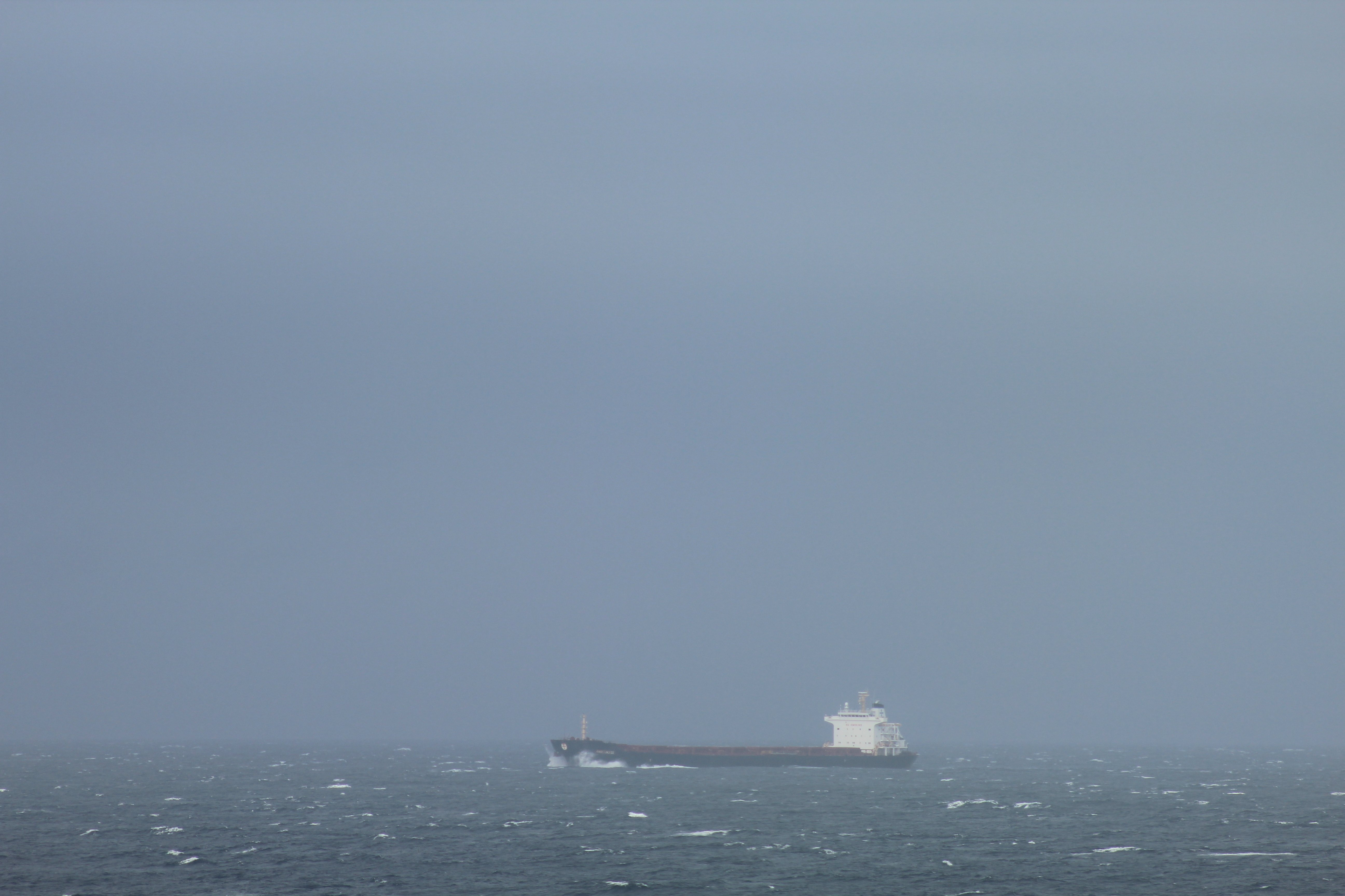 A cargo ship passes through Unimak Pass on its way to Singapore, traveling in the opposite direction of the U.S. Coast Guard icebreaker the Healy on the evening of Wednesday, July 22, 2015. It's about 3,000 yards away from the Healy. There's often a lot more traffic pushing through this path from all over the world. (Kamala Kelkar / Alaska Dispatch News)