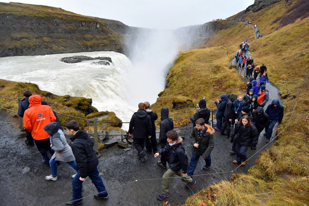 Tourists at Gullfoss waterfall, one of Iceland's many spectacular sights. (Thomas Nilsen / The Independent Barents Observer)