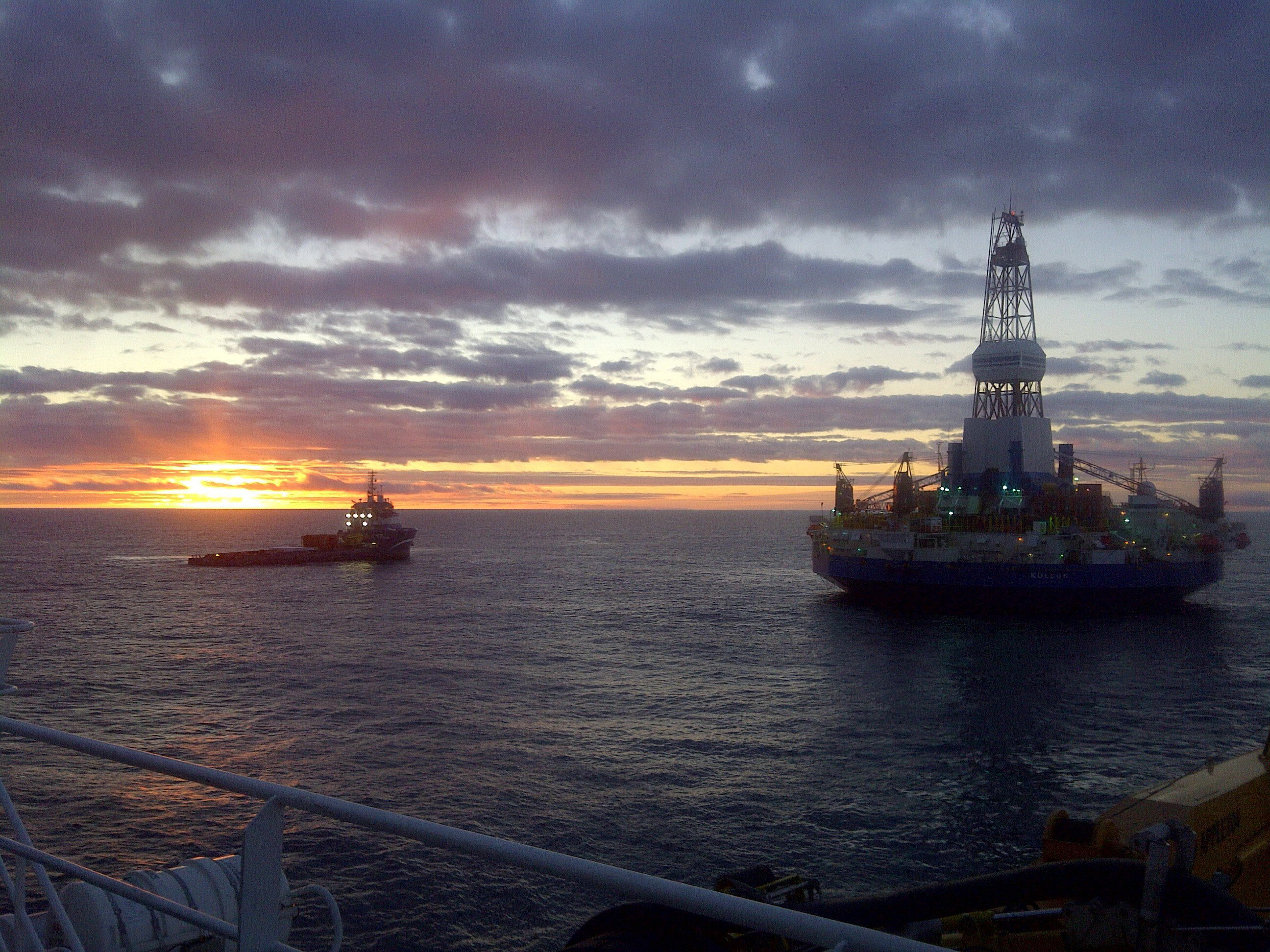 "photo courtesy Shell Alaska The Kulluk conical drilling unit works in the Beaufort Sea at a Shell Alaska prospect recently offshore from the North Slope. The rig was made specifically to drill in Arctic conditions and is owned outright by Shell. Following several weeks of drilling at Shell Alaska OCS prospects, Shell has concluded its 2012 exploratory drilling programs in the Beaufort and Chukchi Seas. ""The work we accomplished in drilling the top portion of the Burger-A well in the Chukchi Sea and the Sivulliq well in the Beaufort Sea will go a long way in positioning Shell for a successful drilling program in 2013,"" said spokesman Curtis Smith. ""Shell deployed numerous assets and rotated thousands of employees to the Arctic for the first time in 20 years. We are very pleased with the work we accomplished this year and look forward to picking up where we left off when the sea ice retreats in 2013."""