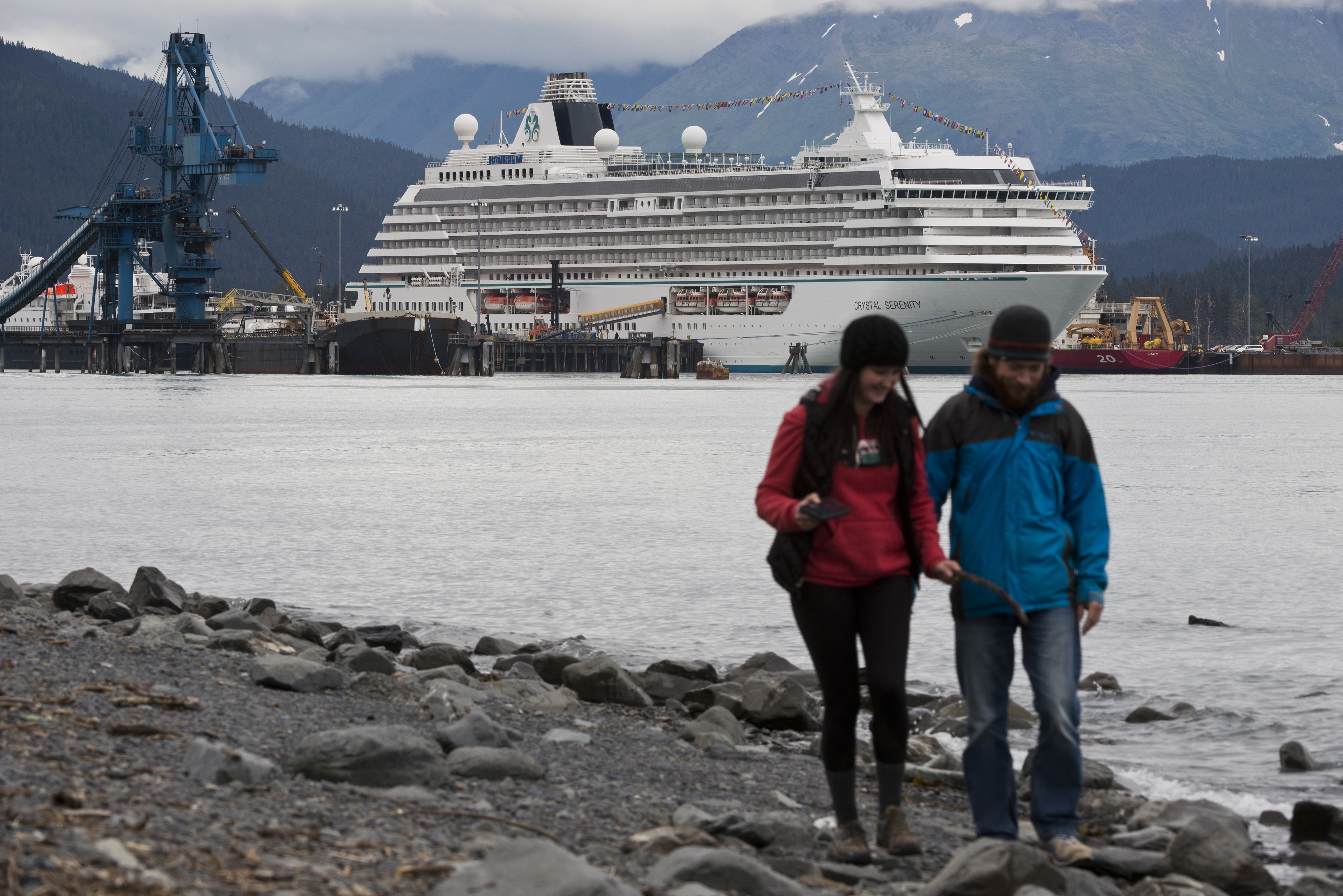 Shawna Nelson, left, and Chad Kaina walk the Resurrection Bay shoreline in Seward. The luxury cruise liner Crystal Serenity is docked in the distance. The Crystal Cruises vessel is on its way to the New York City via the Northwest Passage. The 32-day trip will travel north through the Bering Straight and along the Arctic coast of Alaska and Canada before reaching the Atlantic Ocean. It was scheduled to depart Seward in the early evening on Tuesday, August 16, 2016. The 820-foot long ship can carry 1,070 passengers. Prices for the journey ranged from nearly $22,000 to $120,000. (Marc Lester / Alaska Dispatch News)