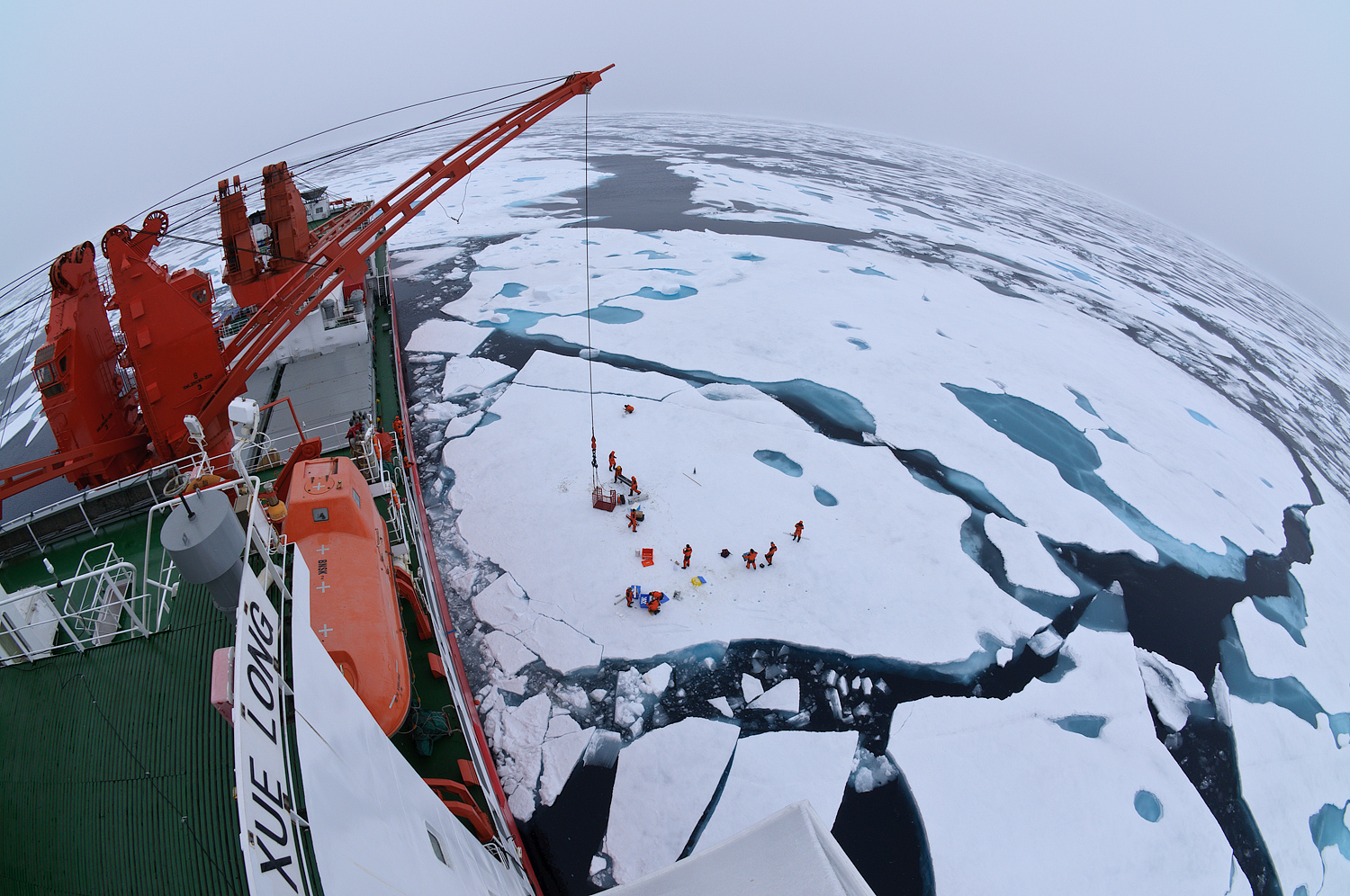 """China's icebreaker Xuelong, or """"Snow Dragon,"""" works alongside a drift ice camp in the Arctic Ocean in 2010. (Timo Palo / CC via Wikimedia Commons)"""