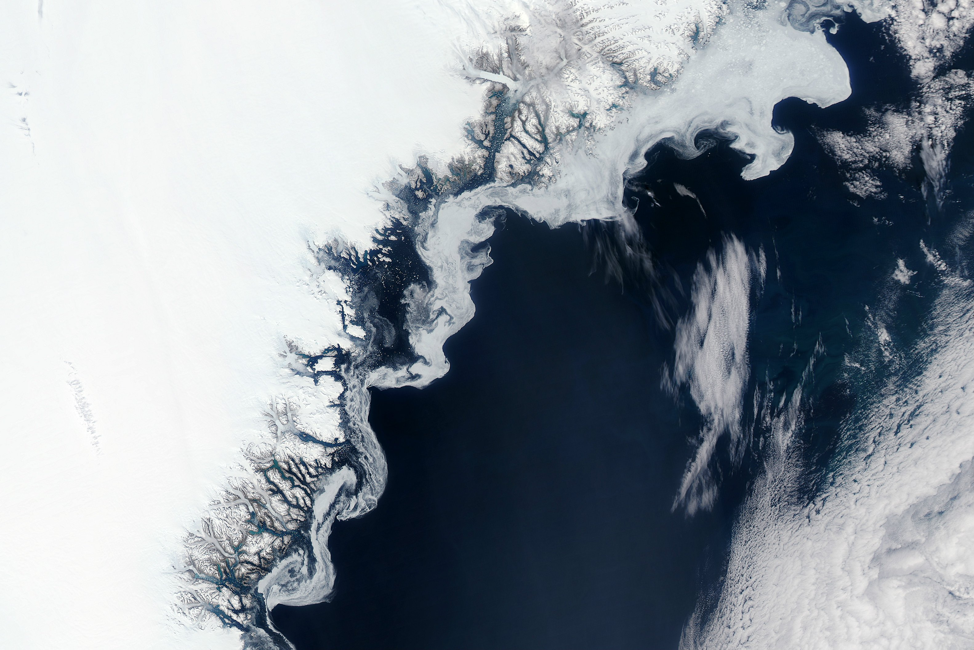 Scientists are trying to predict the impacts of this winter's weird Arctic weather