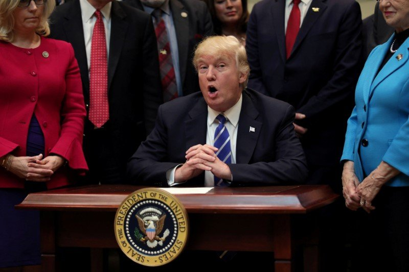 U.S. President Donald Trump speaks during a bill signing event in the Roosevelt room of the White House in Washington, U.S., March 27, 2017. REUTERS/Carlos Barria