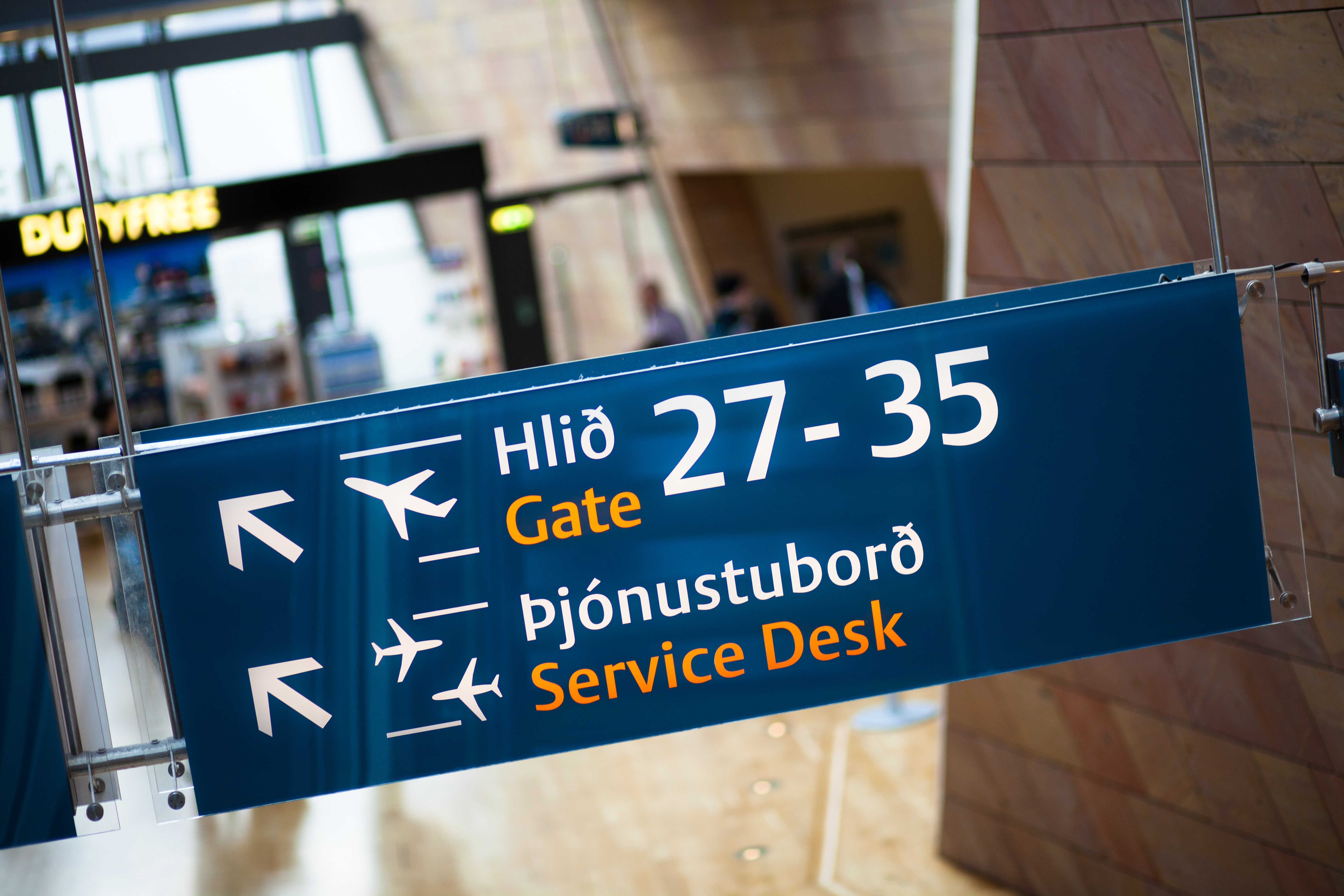 Sign pointing to gates and the service desk in Icelandic and English at Keflavik International Airport outside of Reykjavik, Iceland. (Getty)