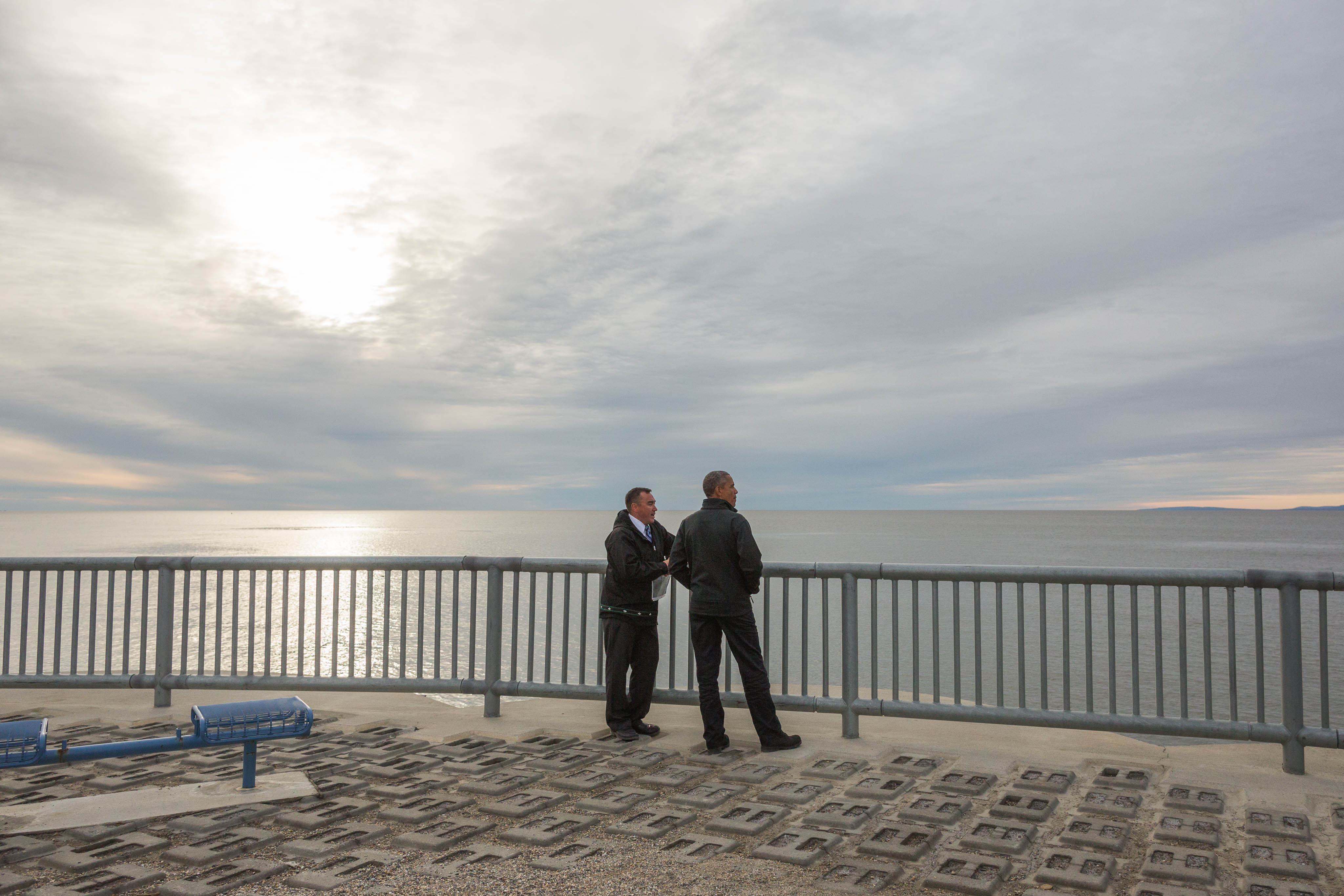 With Kotzebue City Manager Derek Martin, President Obama views the seawall that protects the community from winter storm surges on Wednesday, September 2, 2015.