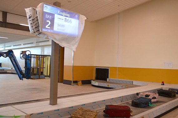 When your flight arrives, you'll pick up your bags at a carrousel like this one, which is now being tested. (Jane George / Nunatsiaq News)