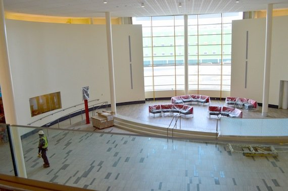 """Here you can see central area of the terminal, the rotunda, with its 40-foot-high (11-metres) ceilings, from a second-floor lookout which John Hawkins, the Government of Nunavut's Iqaluit airport director, calls his """"favourite spot."""" (Jane George / Nunatsiaq News)"""