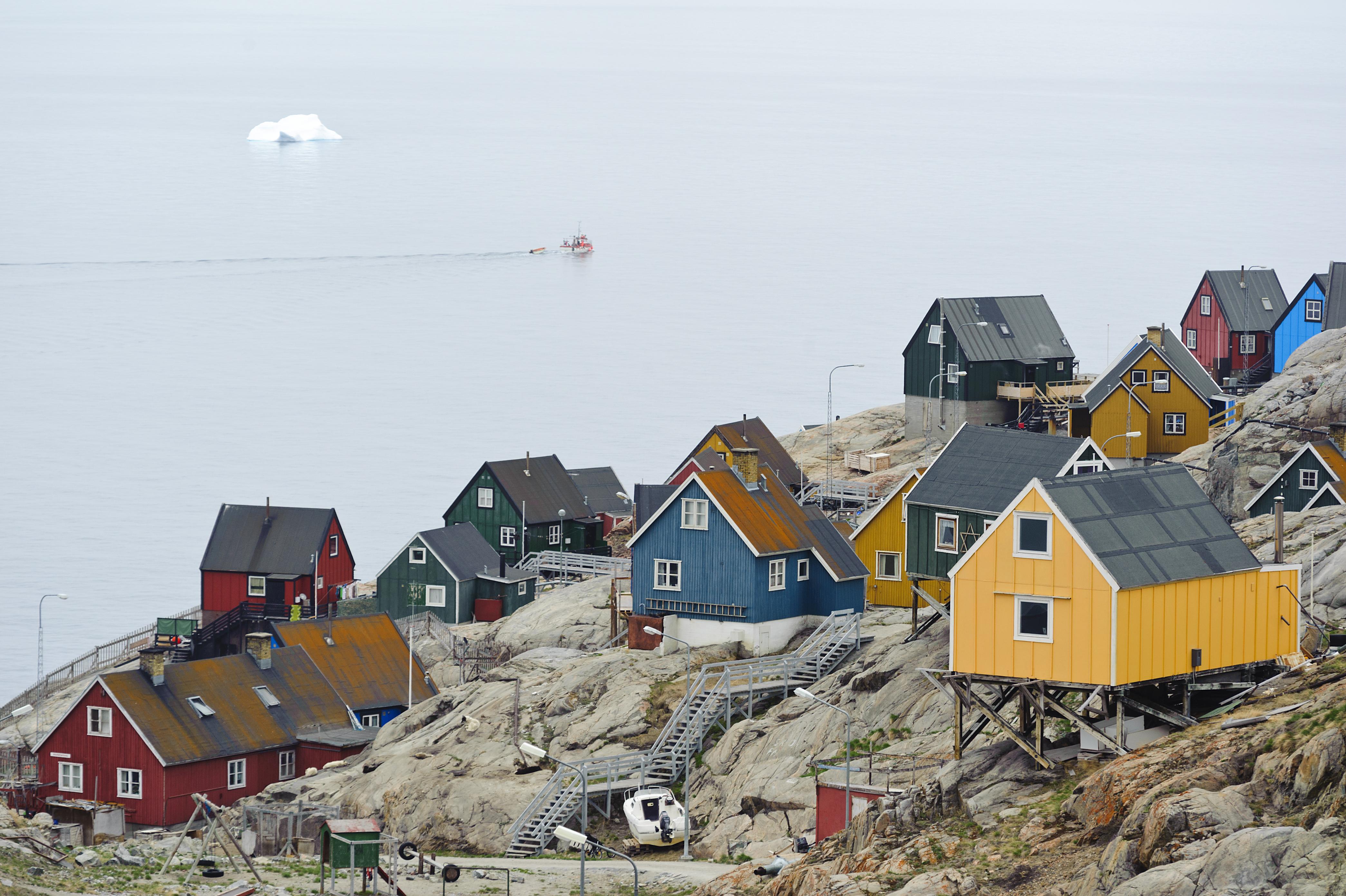 Uummannaq, Greenland - June 15, 2013: Colourful houses perched on a rocky hill in Uummannaq, Greenland. (Getty)