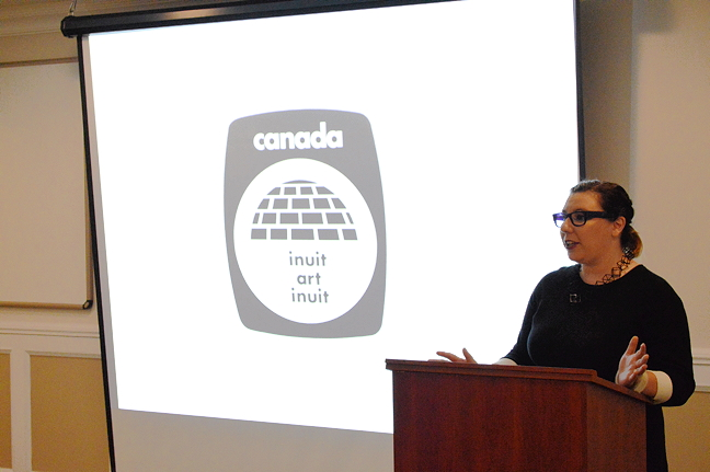 """The Inuit Art Foundation's executive director, Alysa Procida, shows off the new """"Igloo Art"""" certification logo at an announcement in Iqaluit July 7. (Steve Ducharme / Nunatsiaq News)"""