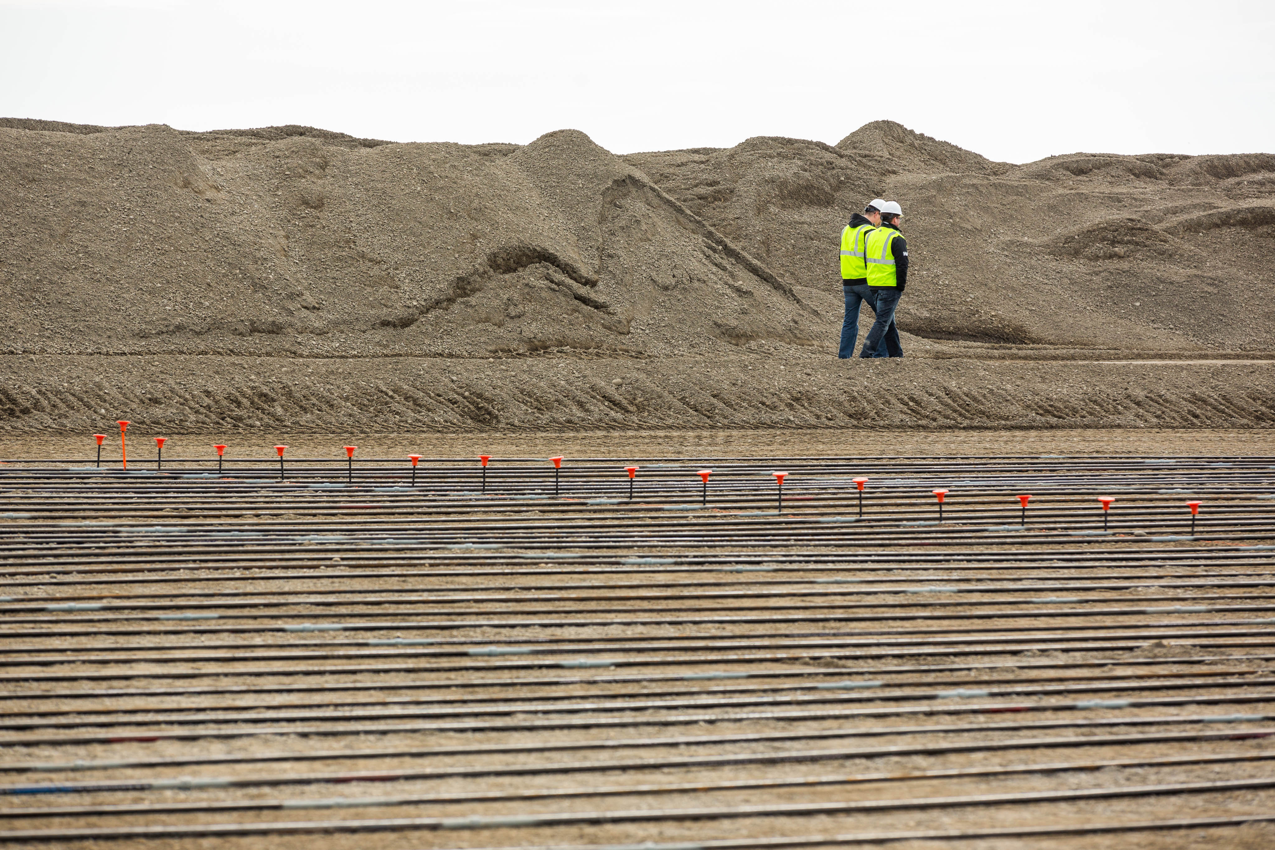 Contractors walk around the site of a new ASRC Energy Services North Slope Maintenance Facility in Deadhorse on Thursday, May 21, 2015. The Arctic Slope Regional Corporation subsidiary is planning for increased activity on Alaska's North Slope oil fields. (Loren Holmes / Alaska Dispatch News)