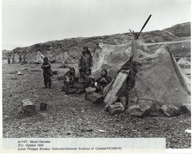 A family sits by a sealskin tupiq at Mount Herodier in 1906. Such tents fell & Nunavut seamstresses are reviving a skin tent tradition - Arctic Today
