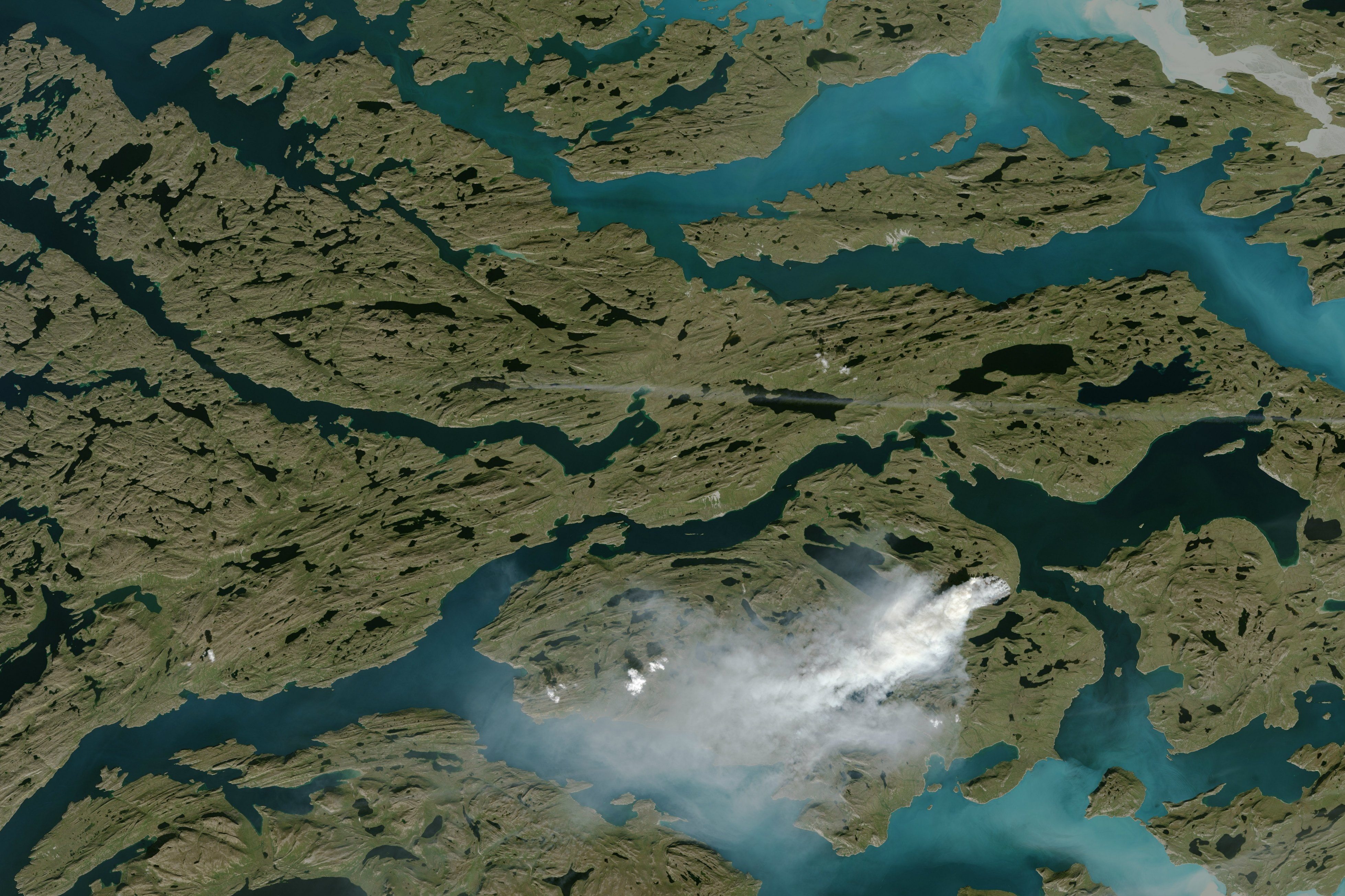 A wildfire burns in western Greenland, about 150 kilometers (90 miles) northeast of Sisimiut. (Jesse Allen / NASA Earth Observatory / USGS Landsat)