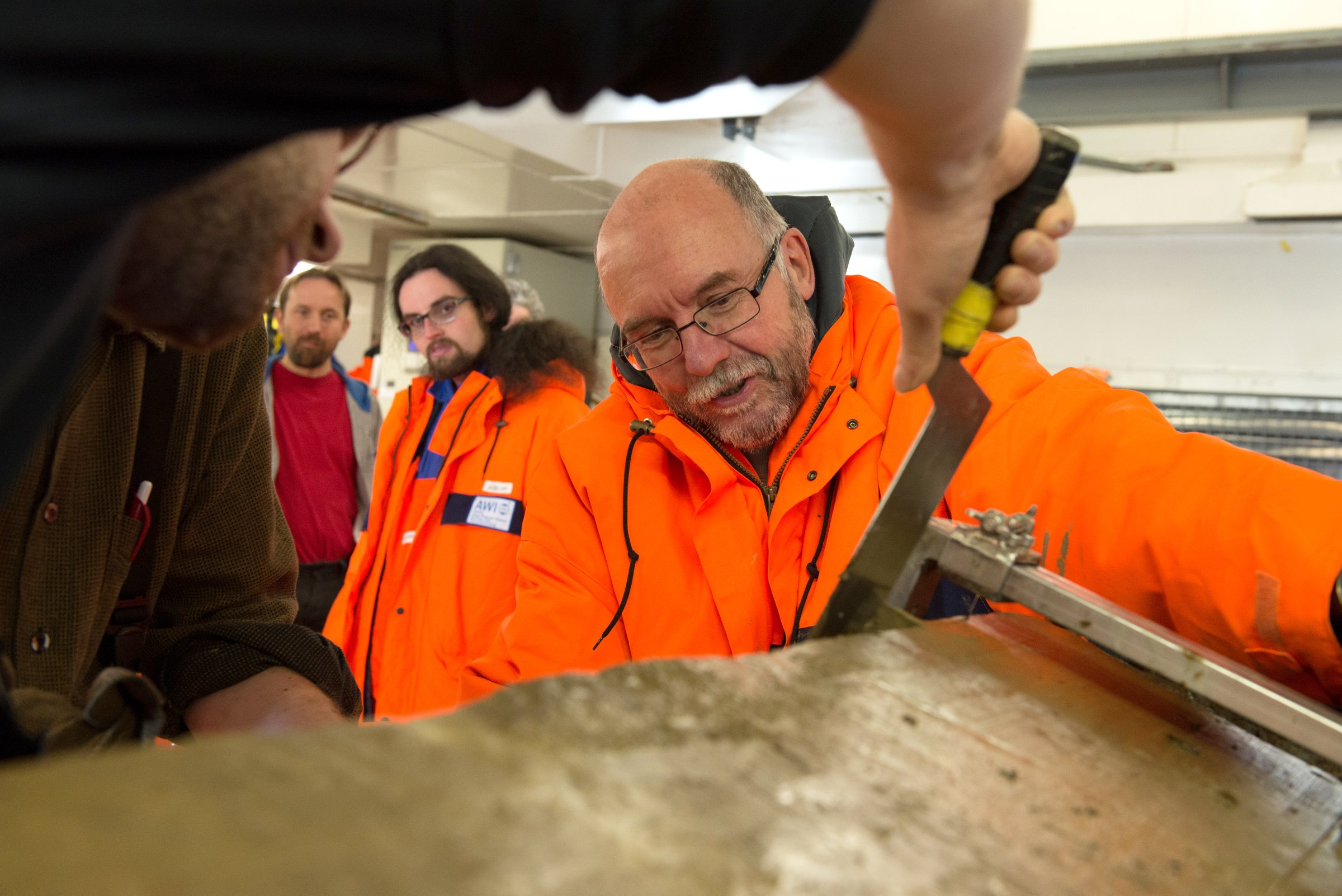 Rüdiger Stein samples a sediment core on board the RV Polarstern in August of 2014. (Audun Tholfsen / Alfred Wegener Institute)