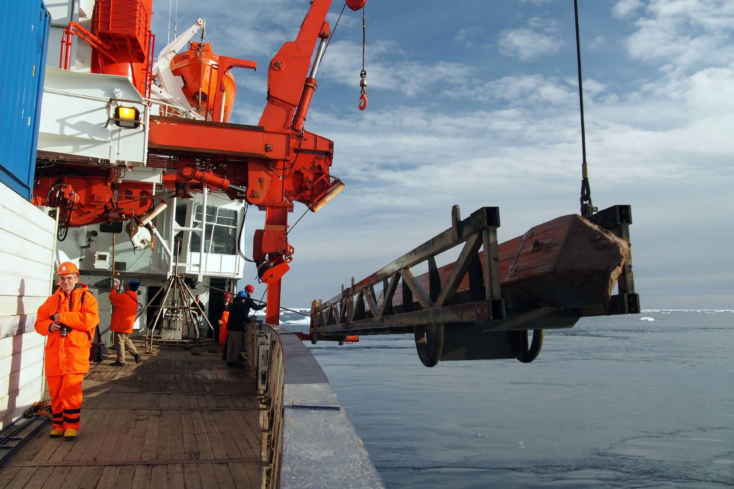 A box core, used to drill into the ocean floor of the East Greenland Shelf and recover sediment cores, is lifted onto the RV Polarstern in July of 2015. (Maciej Telesinski / Alfred Wegener Institute)