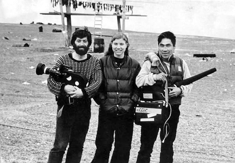 Leonard Kamerling, left, Sarah Elder and Woodrow Malewotkuk, a sound recordist, film in Gambell in April of 1975. (Courtesy Sarah Elder and Leonard Kamerling)