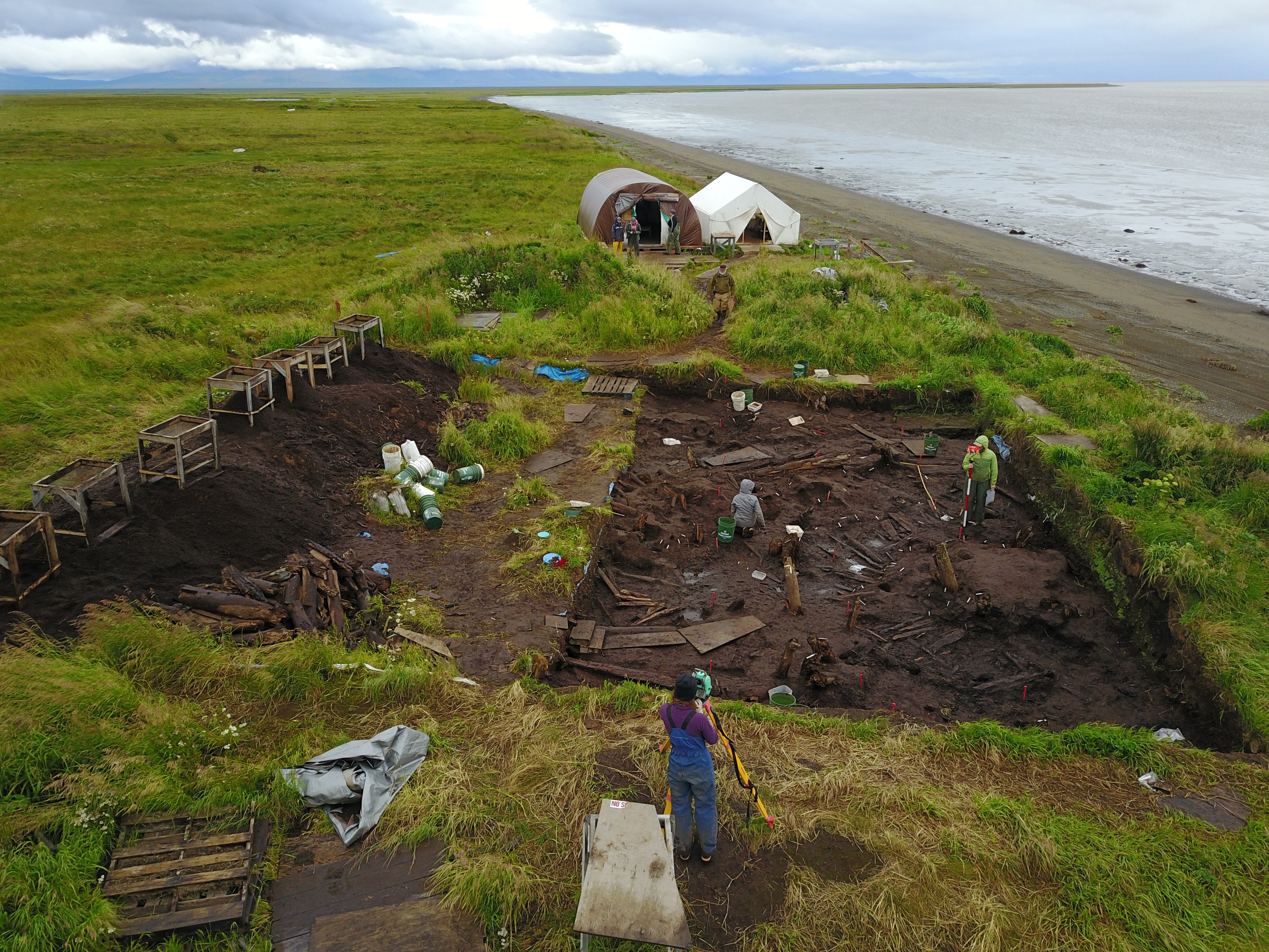The Nunalleq archaeological site sits next to the Bering Sea near Quinhagak. The dig is filled back in at the end of the season to protect it in winter, and sand bags are packed across the face of the bluff to slow erosion. (Sven Haakanson)