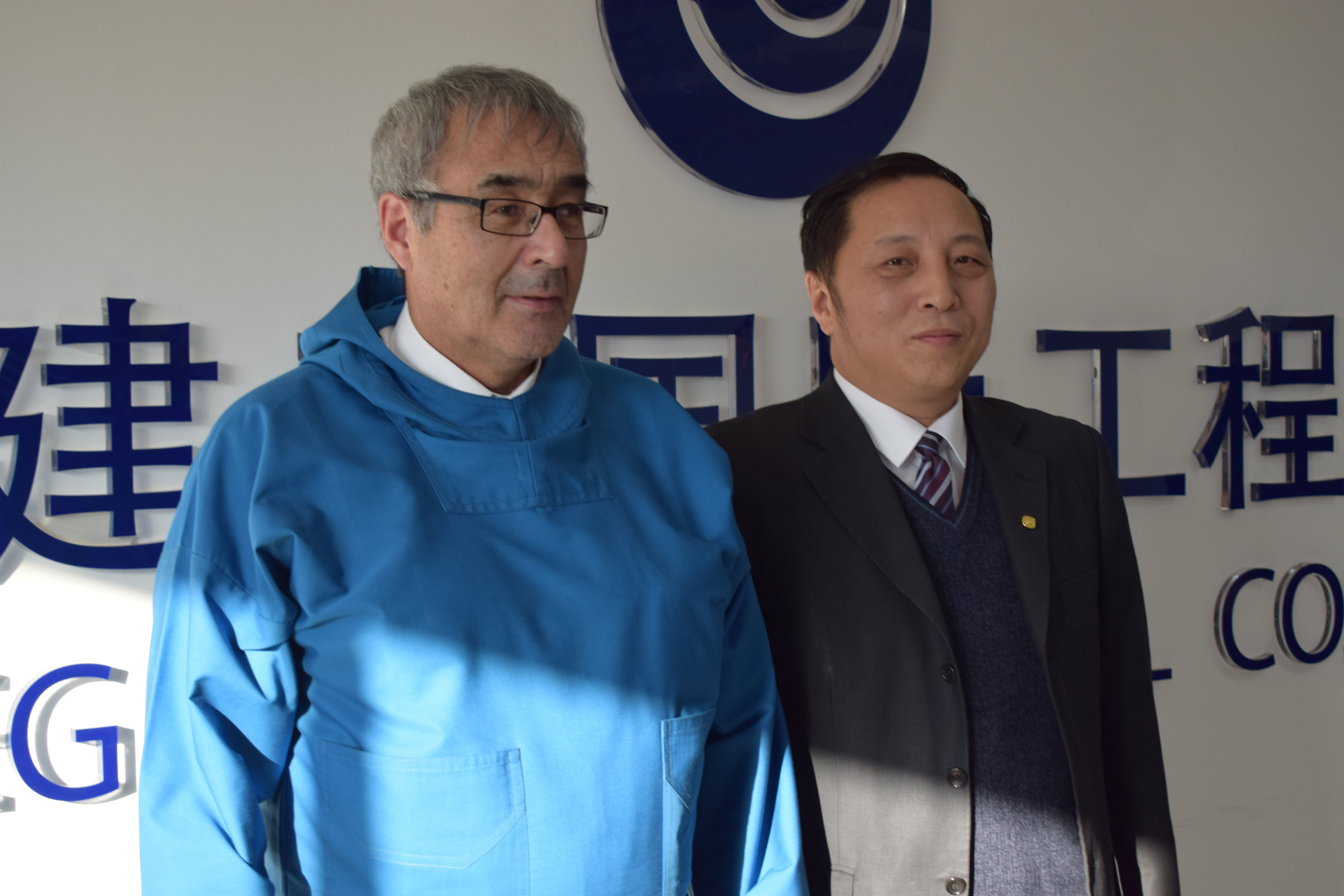 In China, Greenland's commerce minister Hans Enkosen (left) has held a series of meetings with banks and construction firms in an effort to attract investment in the country's plans to build new airports. Here, he is pictured with Wu Junxi of the Beijing Construction Engineering Group, one of the world's largest airport construction firms (Naalakkersuisut)