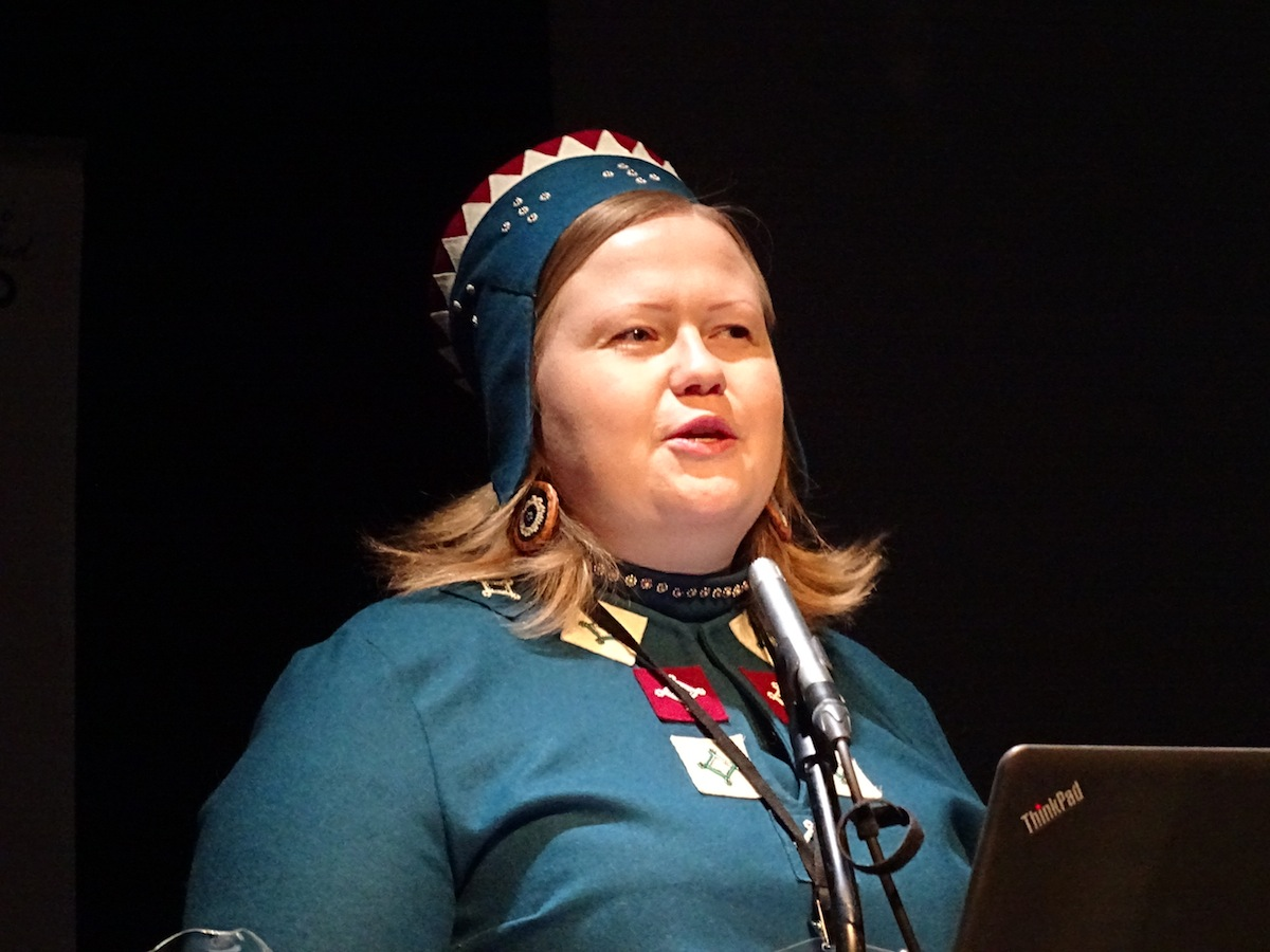 Saami Parliament President Tiina Sanila-Aikio reminds participants at the Arctic Spirit conference in Rovaniemi, Finland about the role and needs of Saami and other Indigenous Arctic peoples during her Nov. 15 keynote speech. (Jane George / Nunatsiaq News)