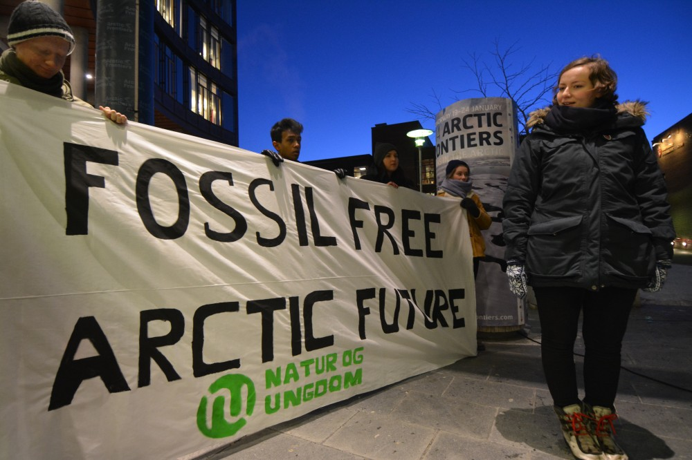 Ingrid Skoldvær and other members of Nature and Youth demonstrated against Arctic oil drilling outside the Arctic Frontiers venue in Tromsø. (Thomas Nilsen The Independent Barents Observer)