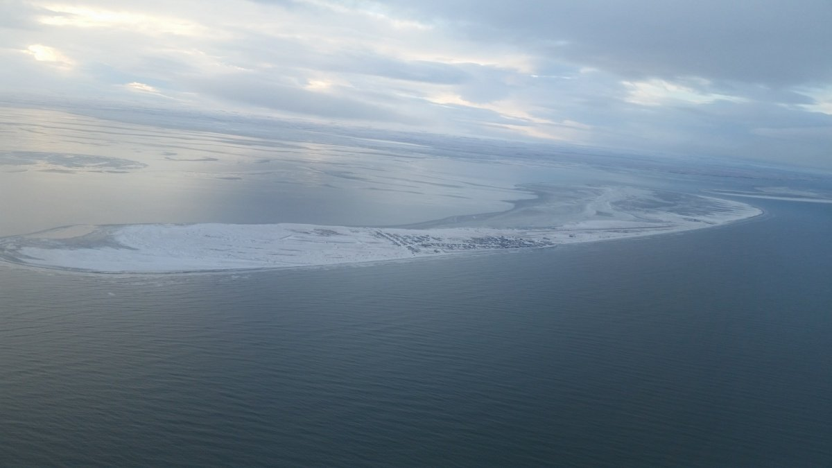 Open water around Shishmaref, Alaska. As sea ice declines, more nutrient-rich sediment from land can be transported to the open ocean where it changes the makeup of marine life. (U.S. Department of the Interior)