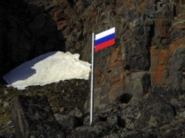 Russian military plants a flag on the nation's northernmost point