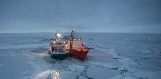 After finding its floe, a drifting Arctic research icebreaker settles in for polar night
