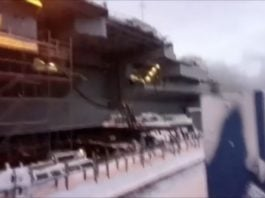 Two soldiers hurt as Russia's only aircraft carrier catches fire in Murmansk