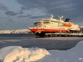 Hurtigruten puts Arctic cruise operations on hold, but two ships will sail supplies