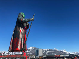 A statue in Greenland is marked with anti-colonial statements
