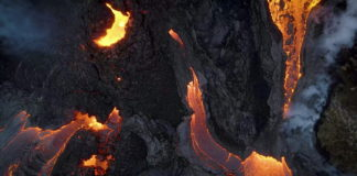 Hikers evacuated as more lava flows from new fissures at Icelandic volcano