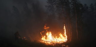 Russian planes seed clouds as raging wildfires near Siberian power plant