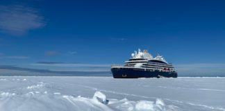 A hybrid-electric luxury cruise ship has reached the North Pole for the first time